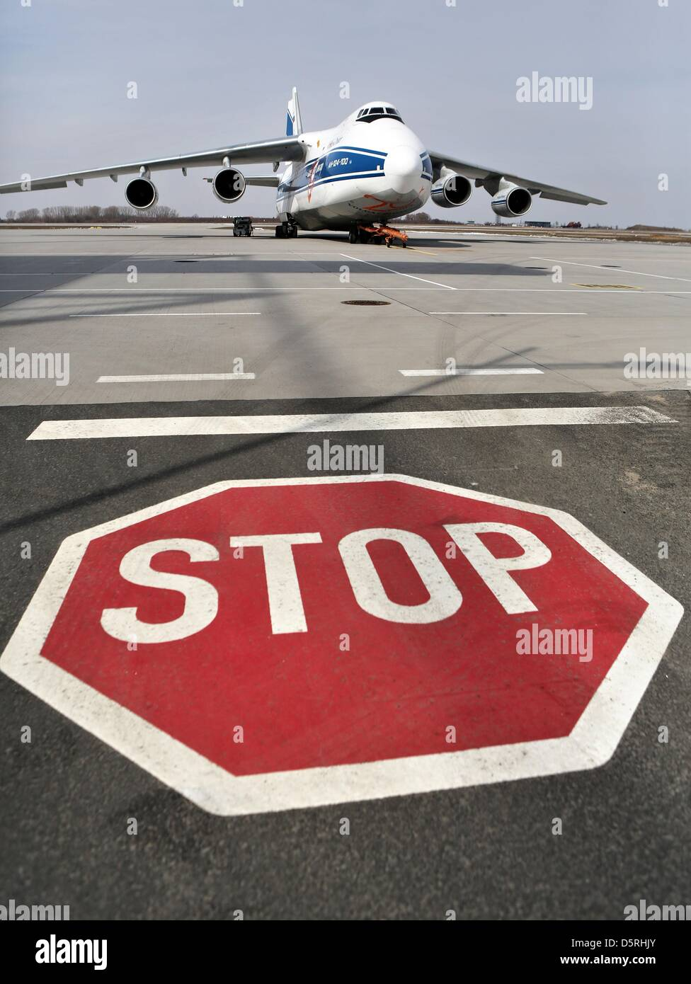 An Antonov An-124 is parked behind a stop sign at Leipzig/Halle Airport in Schkeuditz, Germany, 08 April 2013. The Stock Photo