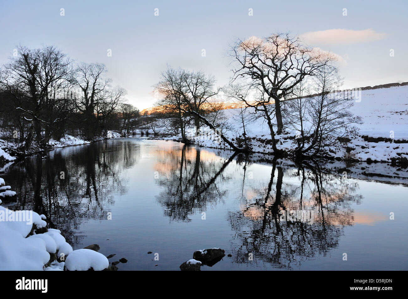 Evening River Wharfe near Hebden North Yorkshire England, in snow. reflections in the river. Stock Photo