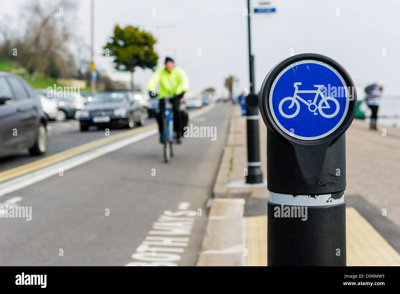 A bollard with the sign of a bicycle next to the cycle lane on Southend seafront, UK - Stock Image