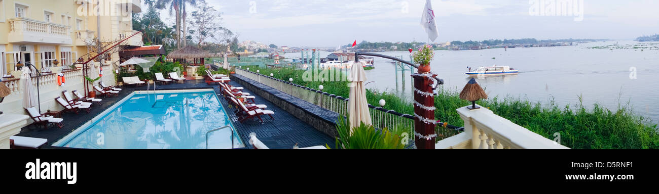 panoramic view of swimmming pool of Victoria Hotel on the Bassac River stretch of the Mekong; Chau Doc; Vietnam - Stock Image