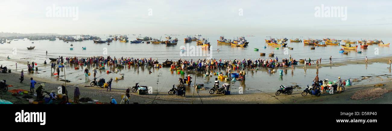 Daily early morning fish market on beach at village of Mui Ne, popular tourist resort on Vietnamese coast near Phan Stock Photo