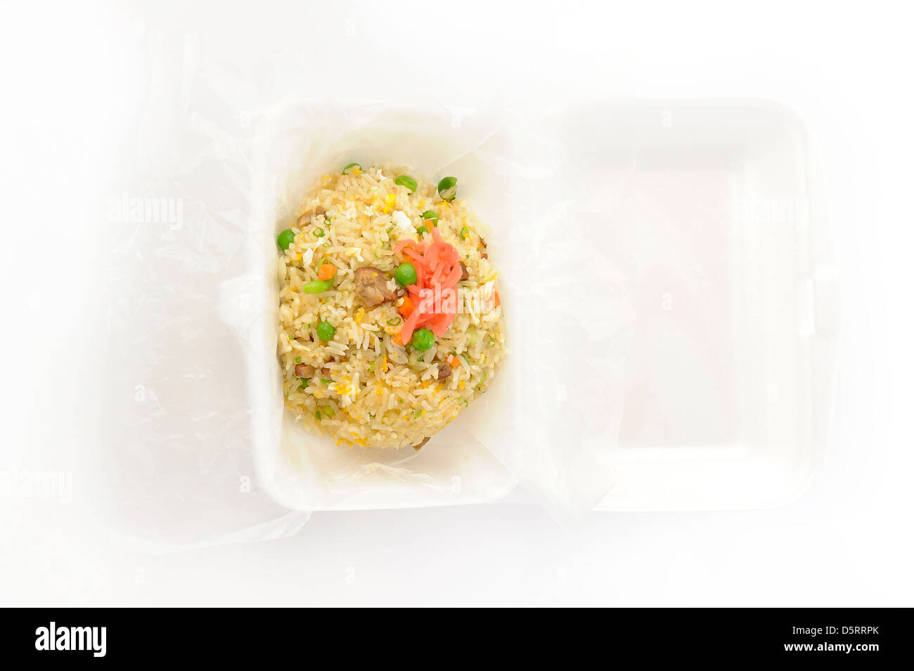 Pork fried rice with peas in foam box - Stock Image