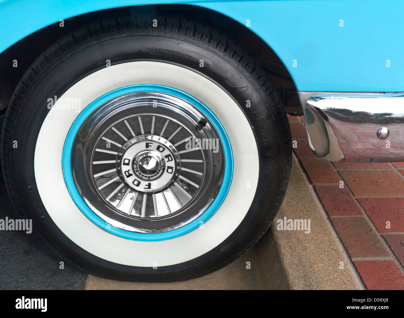 Detail on 1950's Ford Fairlane Skyliner American classic motor chrome wheel cap and whitewall tyre - Stock Image