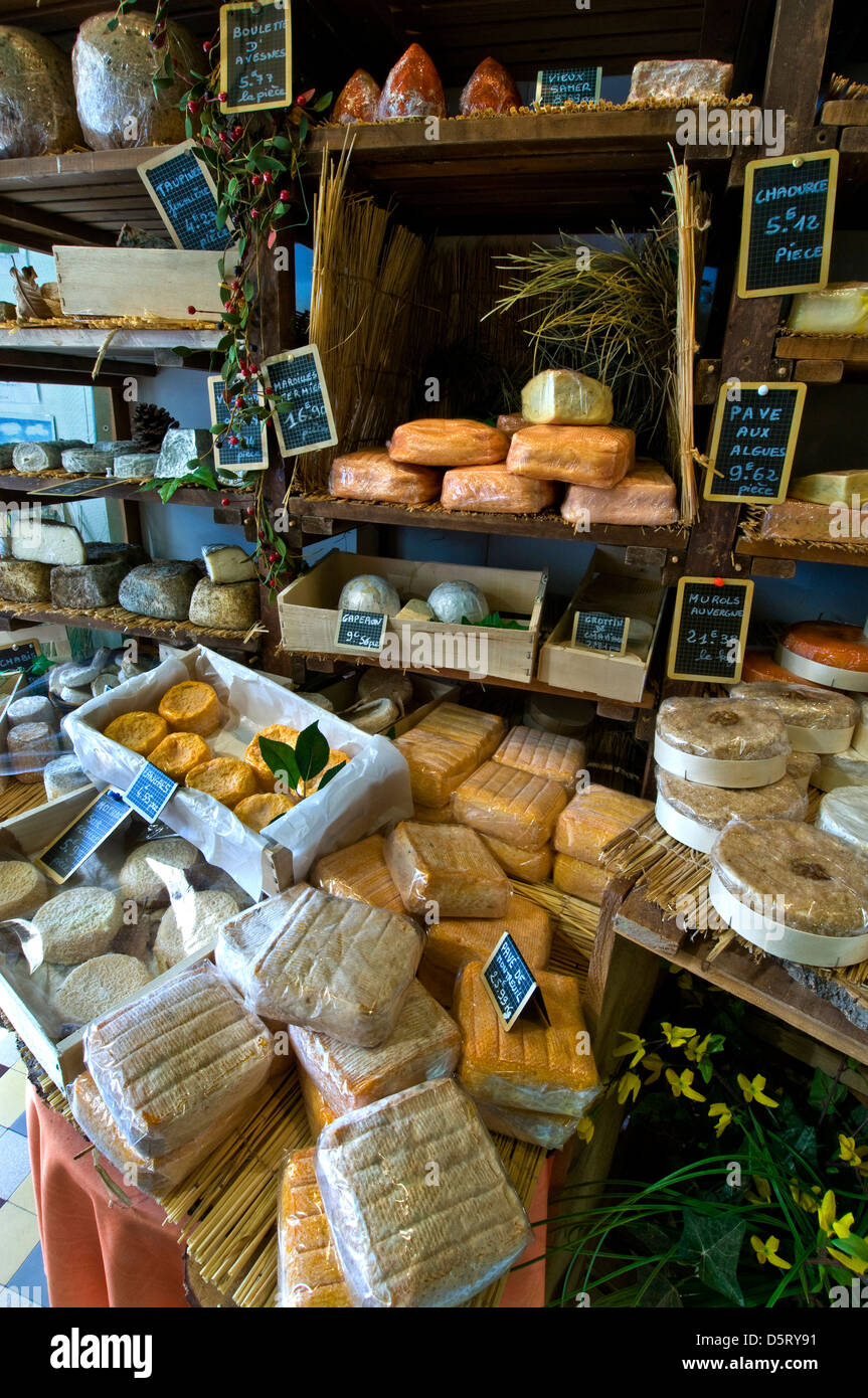 French artisan cheese shop with selection of own handmade cheeses on display in the artisan fromagerie cheese shop - Stock Image