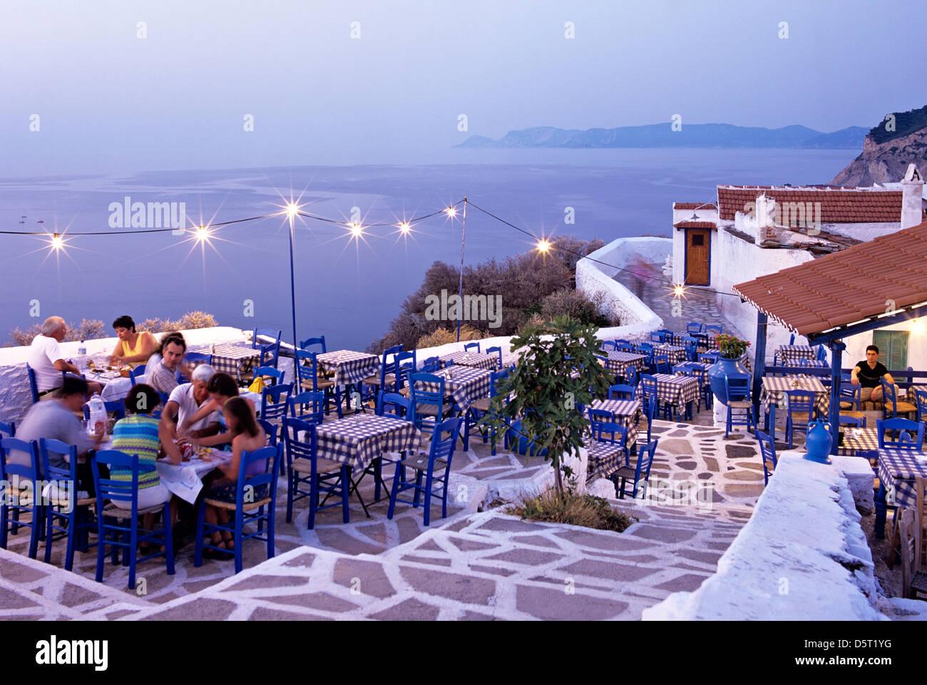 A Taverna at Dusk Skopelos Greek Islands Hellas - Stock Image