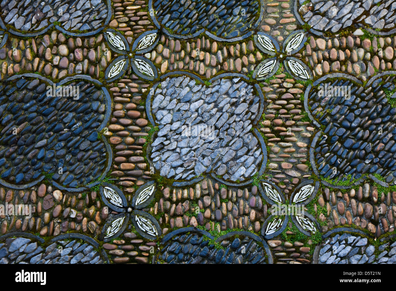 Decorative floor pattern of an outdoor space at the Sun Yat-Sen Chinese Garden, Vancouver, Canada - Stock Image