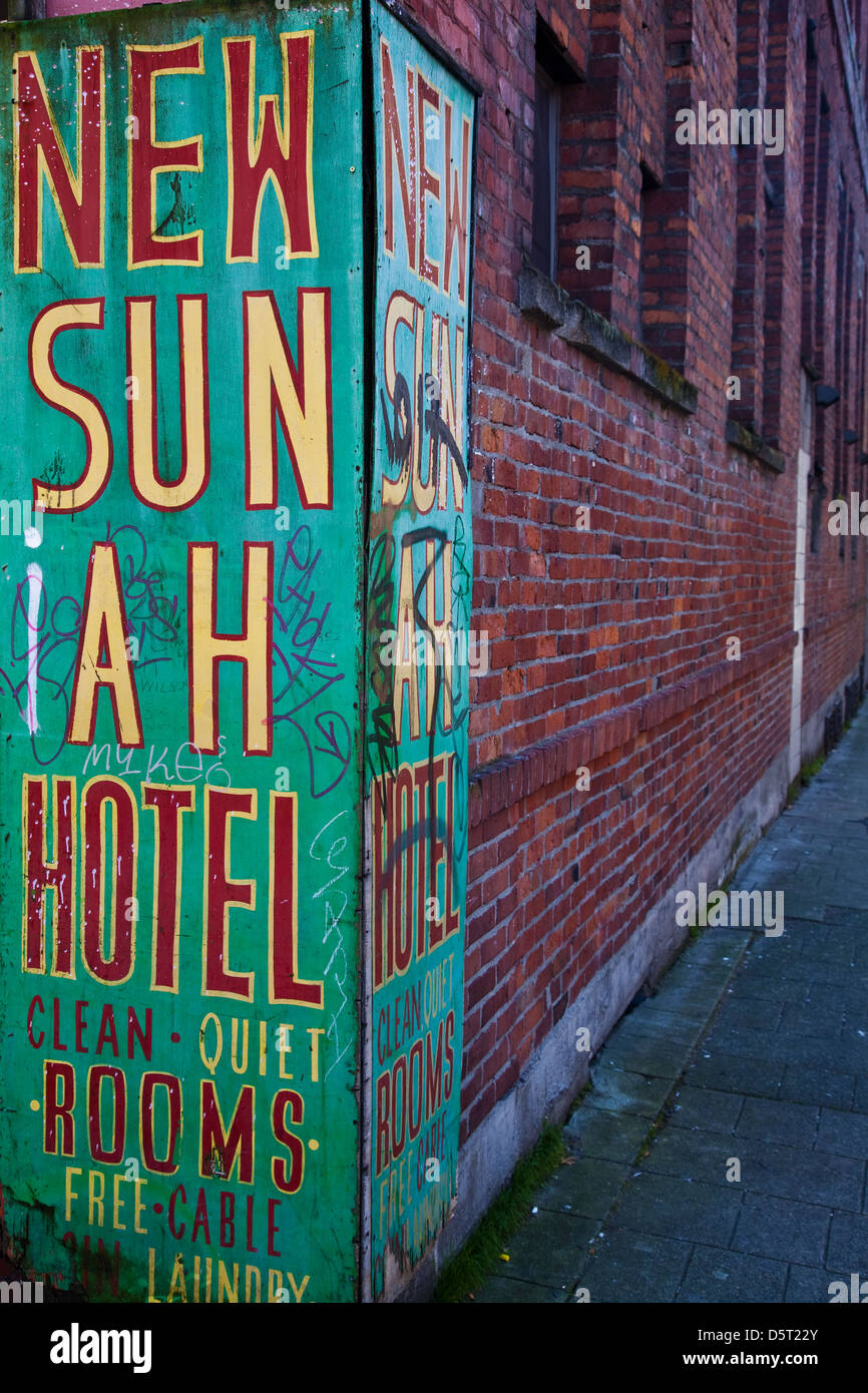 Corner sign for a very low-cost hotel in Chinatown, Vancouver - Stock Image