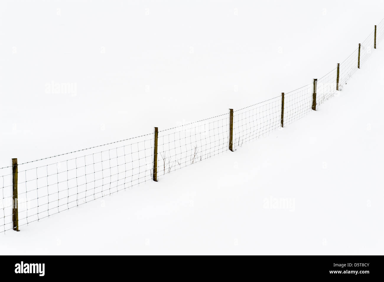 Snow-covered fields and fences make abstract patterns during the UK's cold spring of 2013 - Stock Image