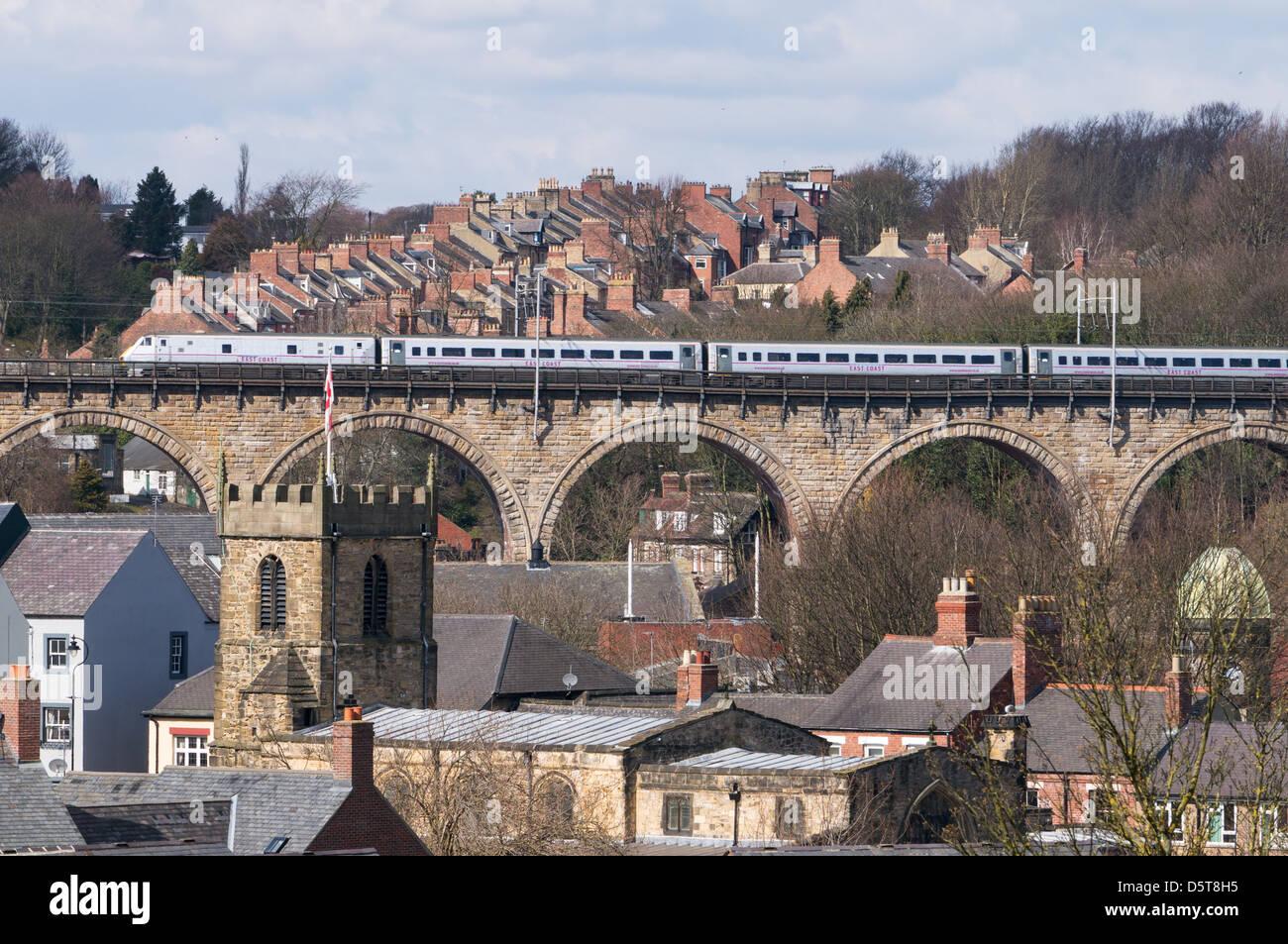 East coast express passenger train crosses Durham railway viaduct north east England UK - Stock Image