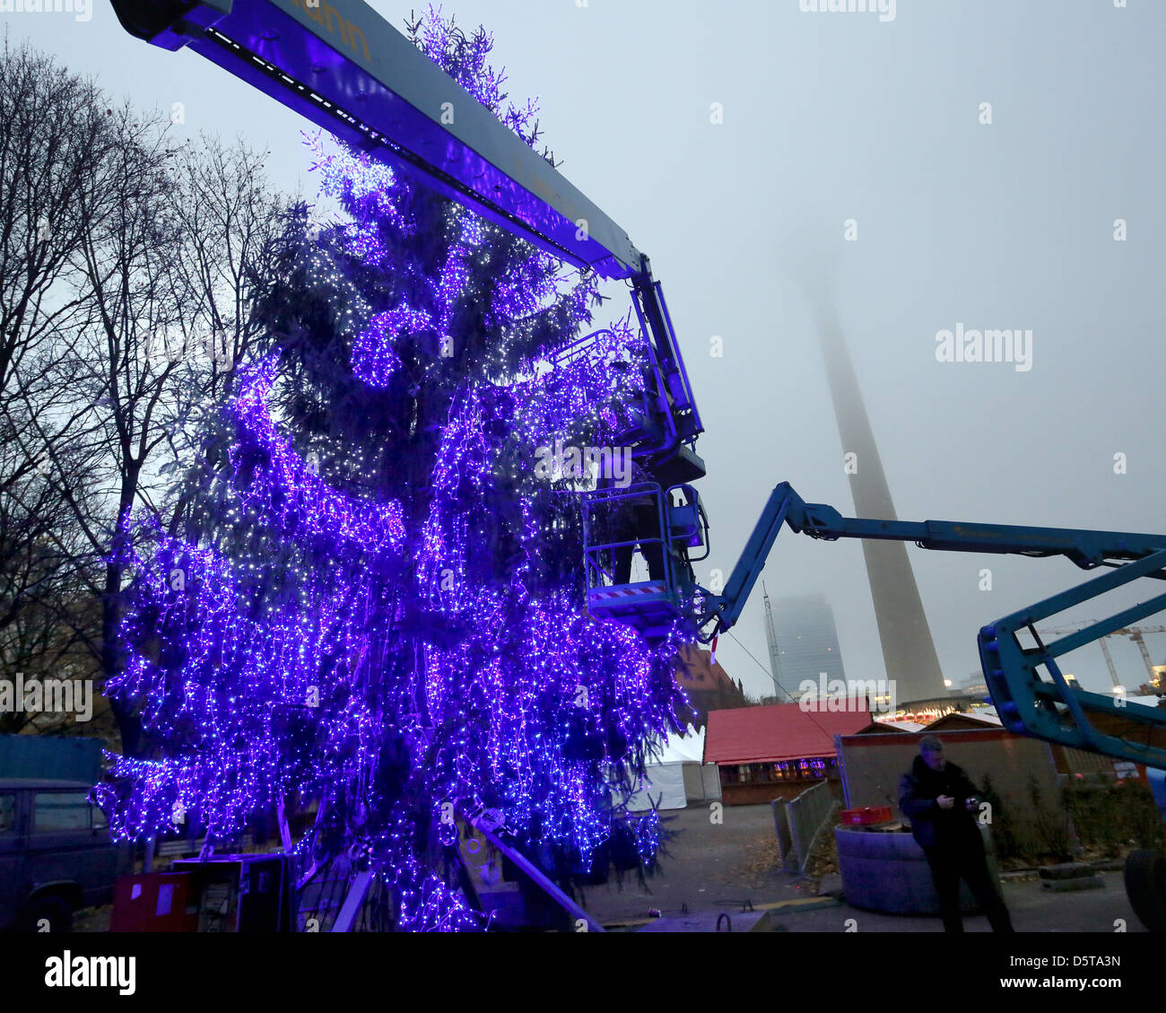 a christmas tree with blue lights is pictured on the square before the city hall in berlin germany 19 november 2012 numerous decorated christmas trees