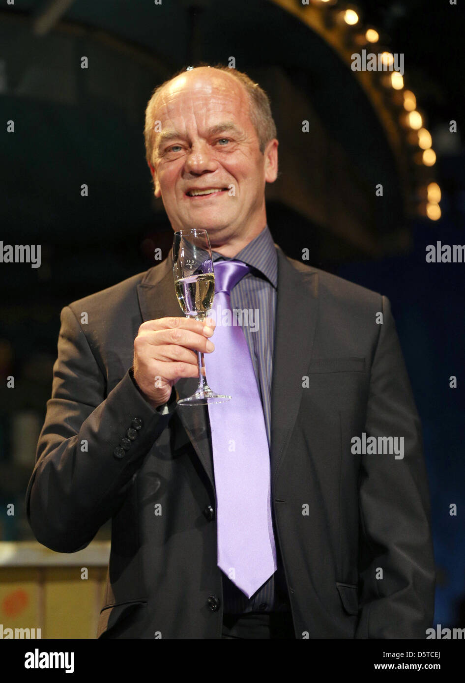 Entertainer and theatre owner Corny Littmann hold a glass of champagne on the stage at Schmidt's Tivoli Theatre - Stock Image