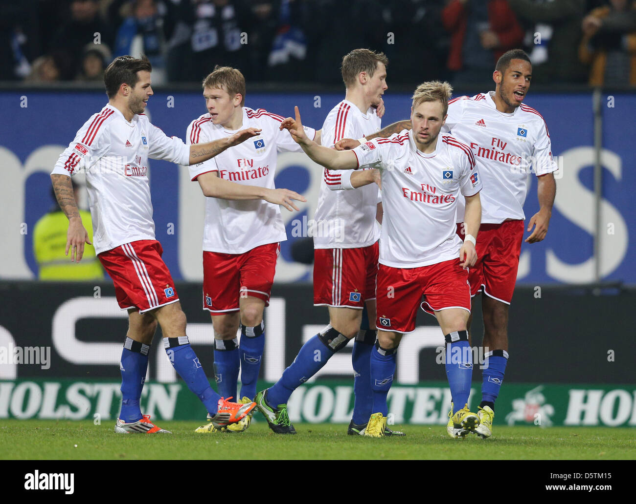 Hamburg's Maximilian Beister (2-R) celebrates his 1-0 goal with his teammates during the German Bundesliga match - Stock Image