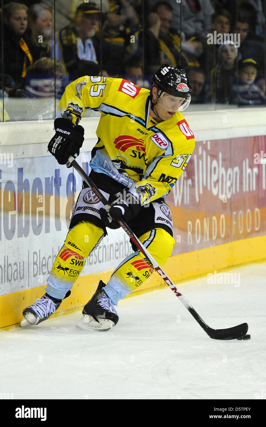 Krefeld's Christian Ehrhoff controls the puck during the German Ice Hockey League (DEL) match Krefeld Pinguine vs Stock Photo