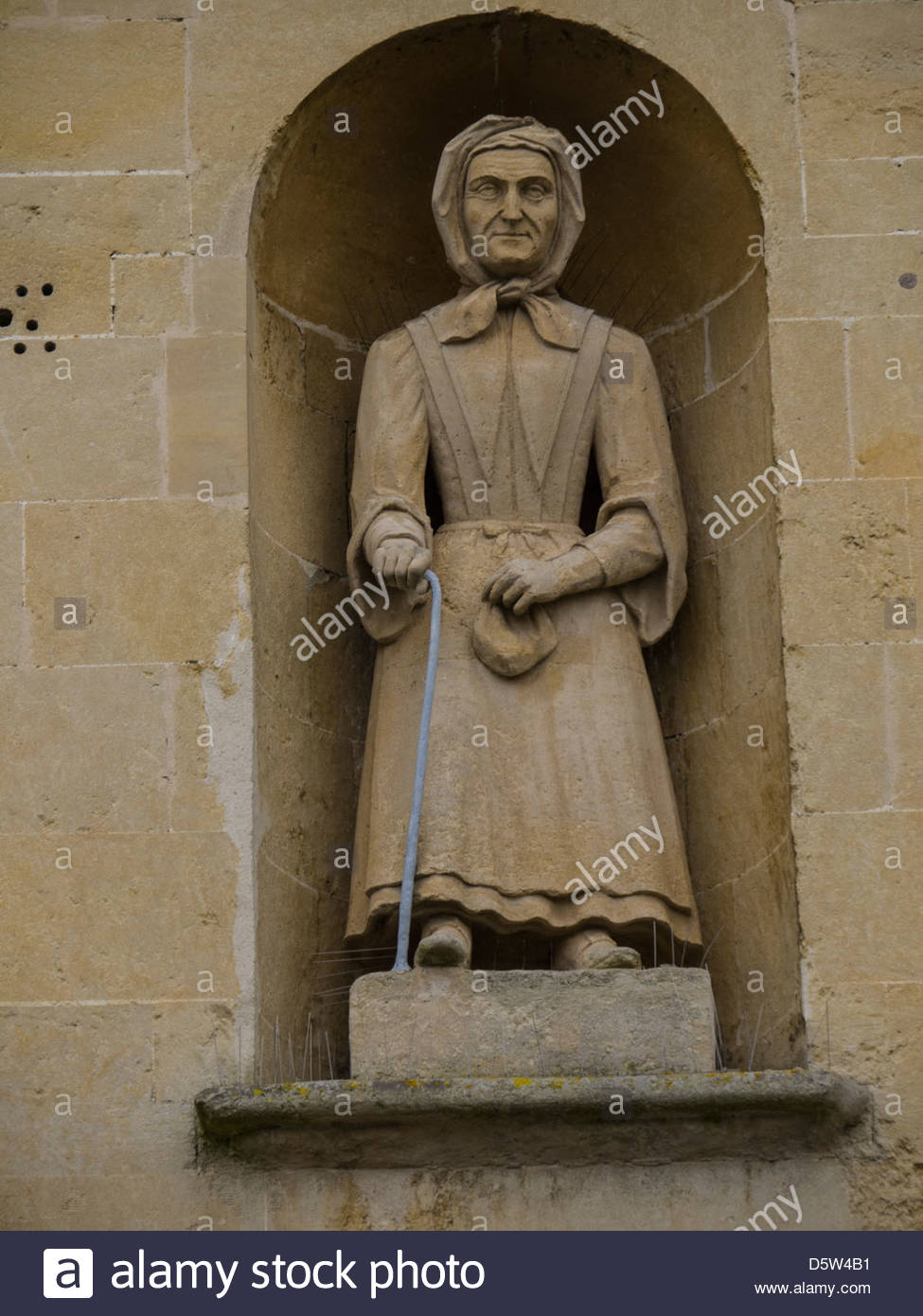 Almshouse 1465 Statues of Almswoman Billy Ball England Frome Nanmcy Guy Places Schoolboy Somerset The Blue House - Stock Image