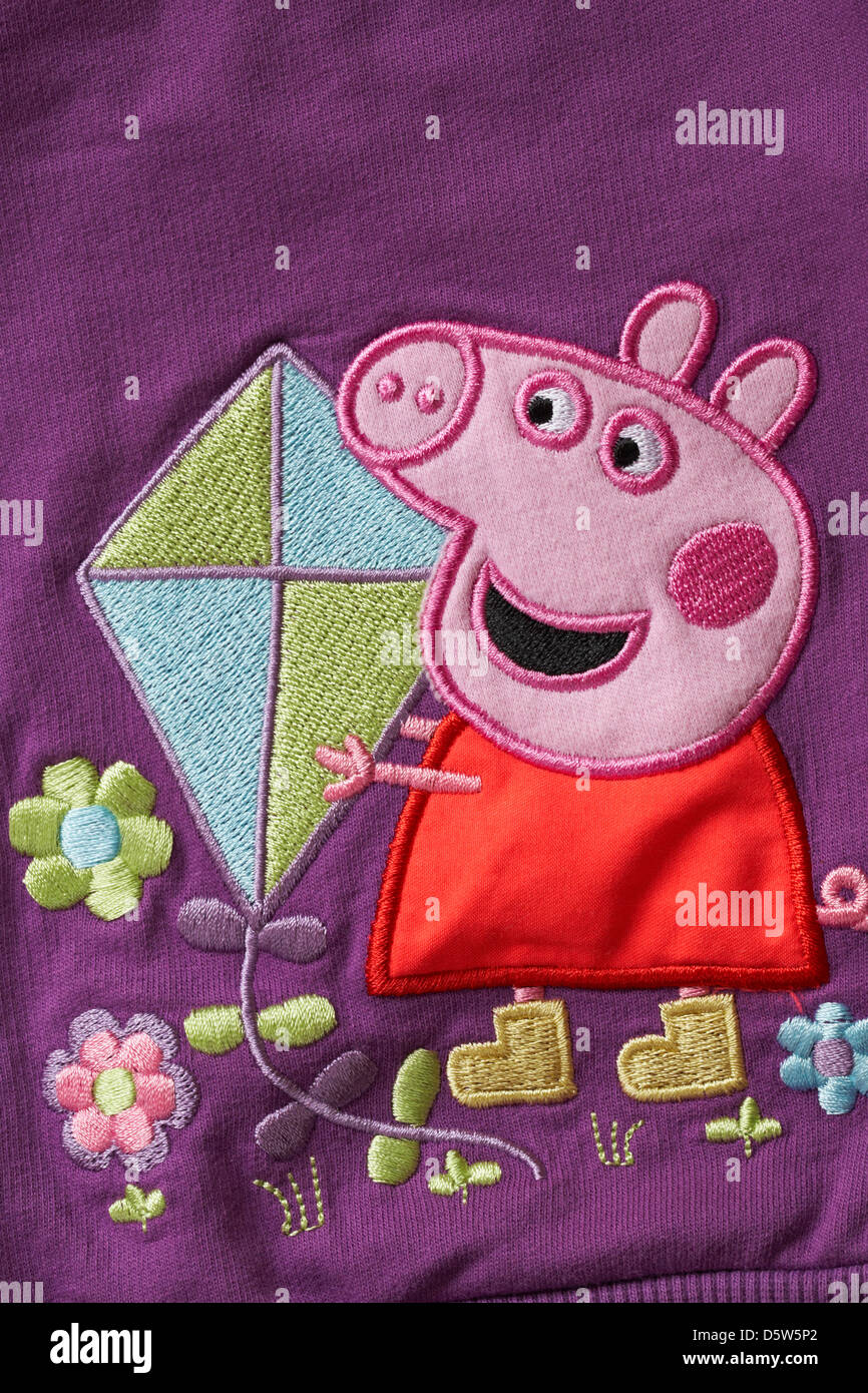 peppa pig holding a kite detail on childs clothing garment Stock Photo