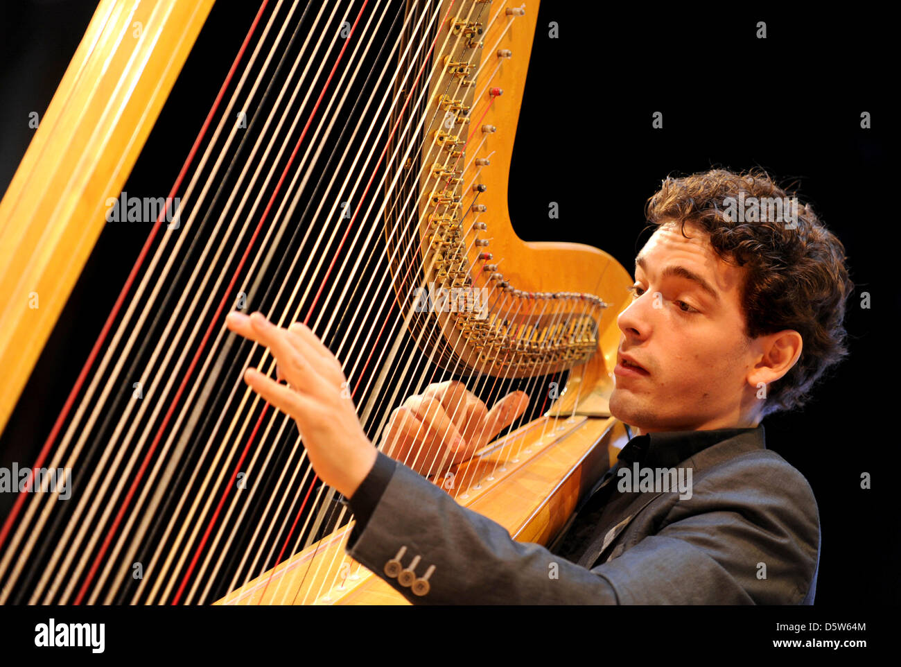 Dutch Harpist Remy Van Kesteren Performs During A Press