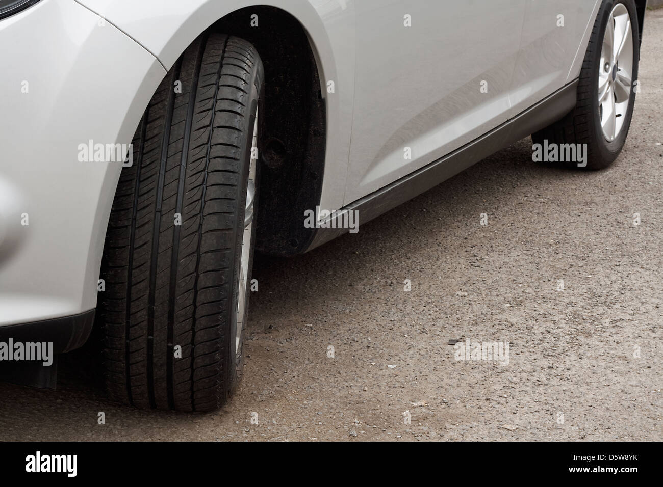 brand new set of unworn tyres on a motor vehicle or car Stock Photo