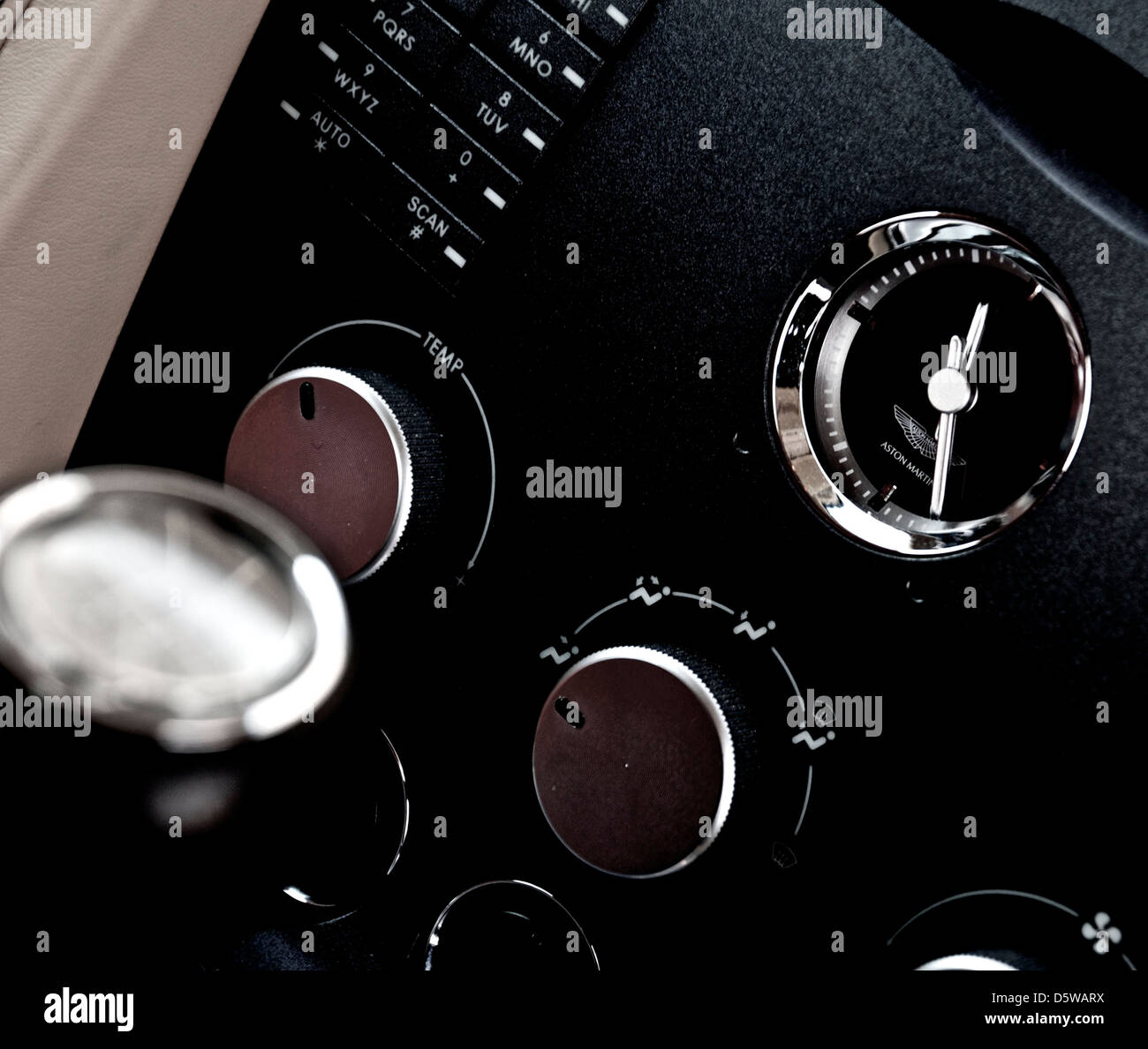 aston martin dash board showing the clock gear lever and some controls - Stock Image