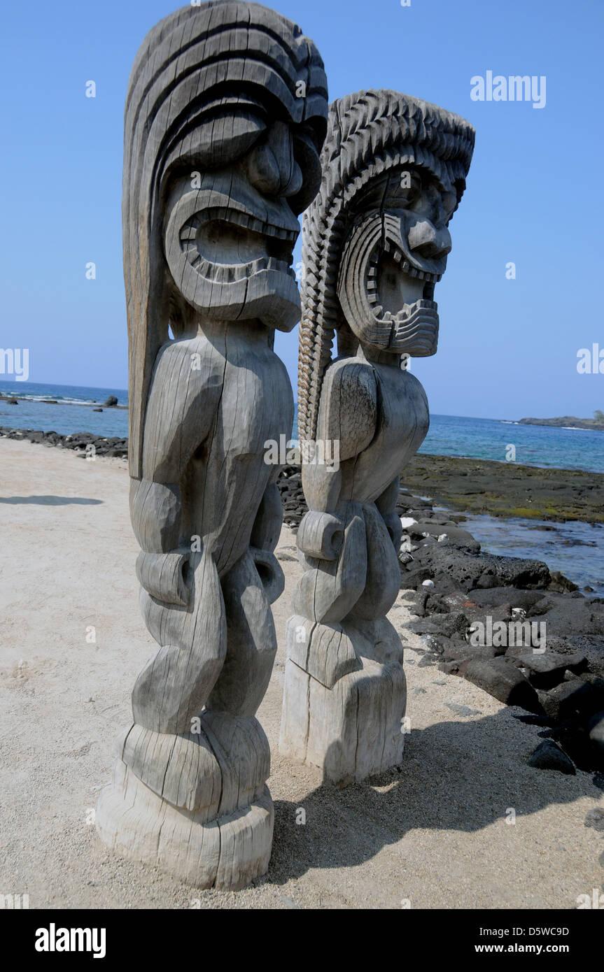 The Guardians of The Place of Refuge, Pu'uhonua o Honaunau on the Kona coast of Big Island, Hawaii. - Stock Image