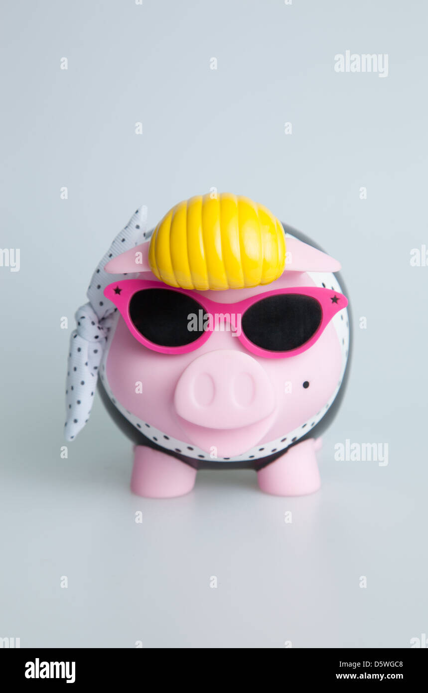 Pink Rock n Roll Piggybank with sunglasses - Stock Image