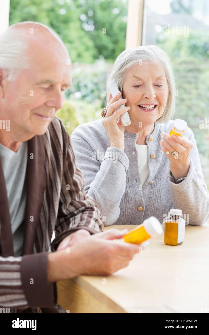 Older couple taking medication - Stock Image