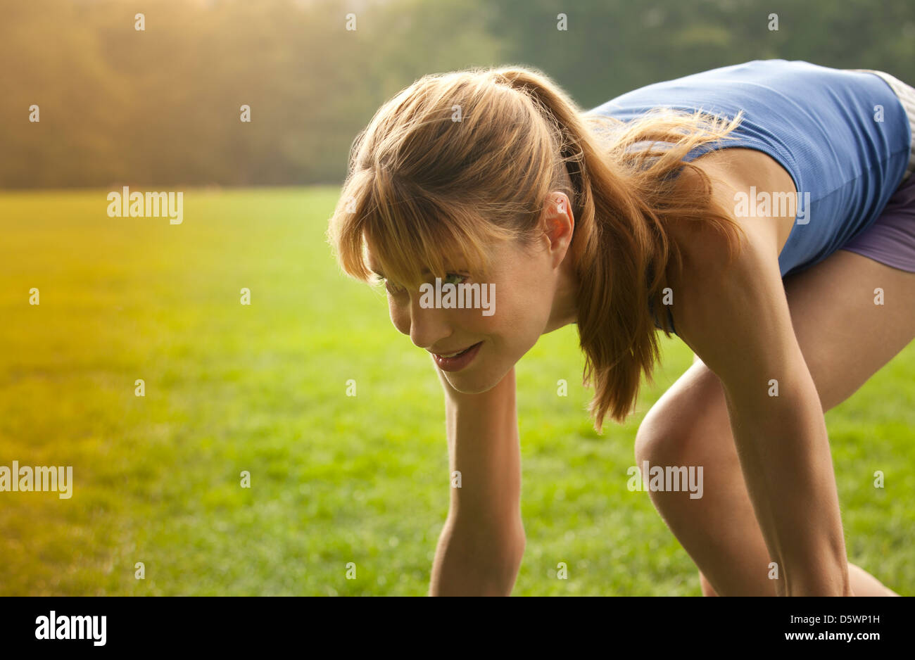 Runner in stance at park - Stock Image