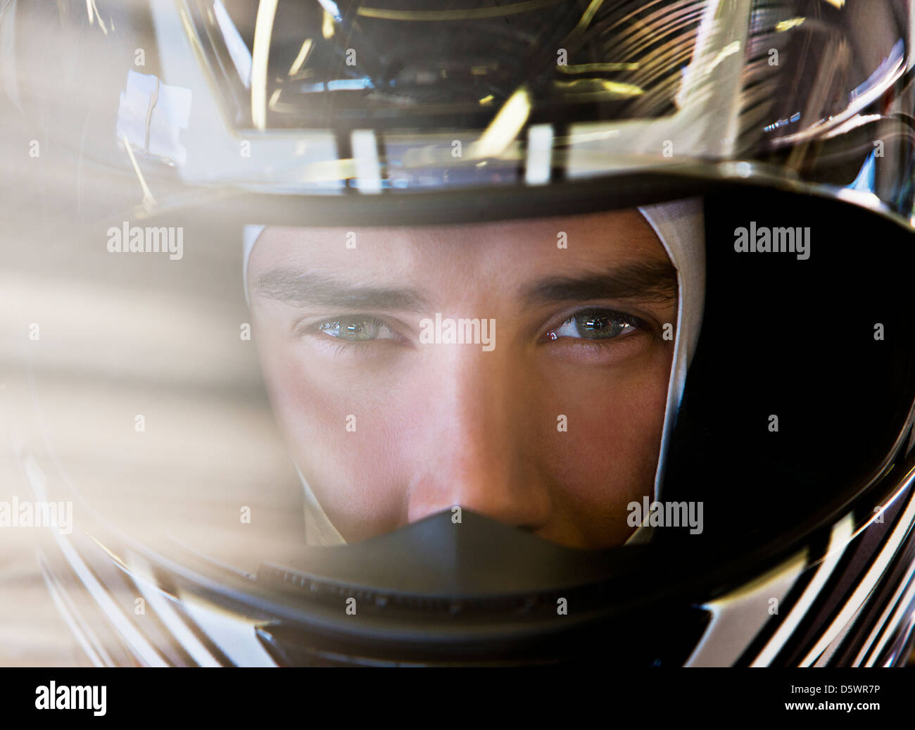Close up of racer wearing helmet - Stock Image