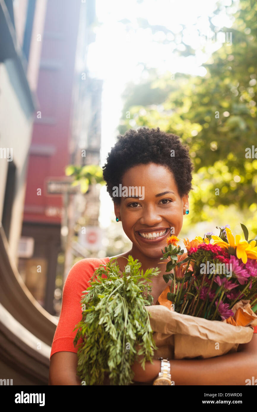 Woman holding bag of groceries - Stock Image