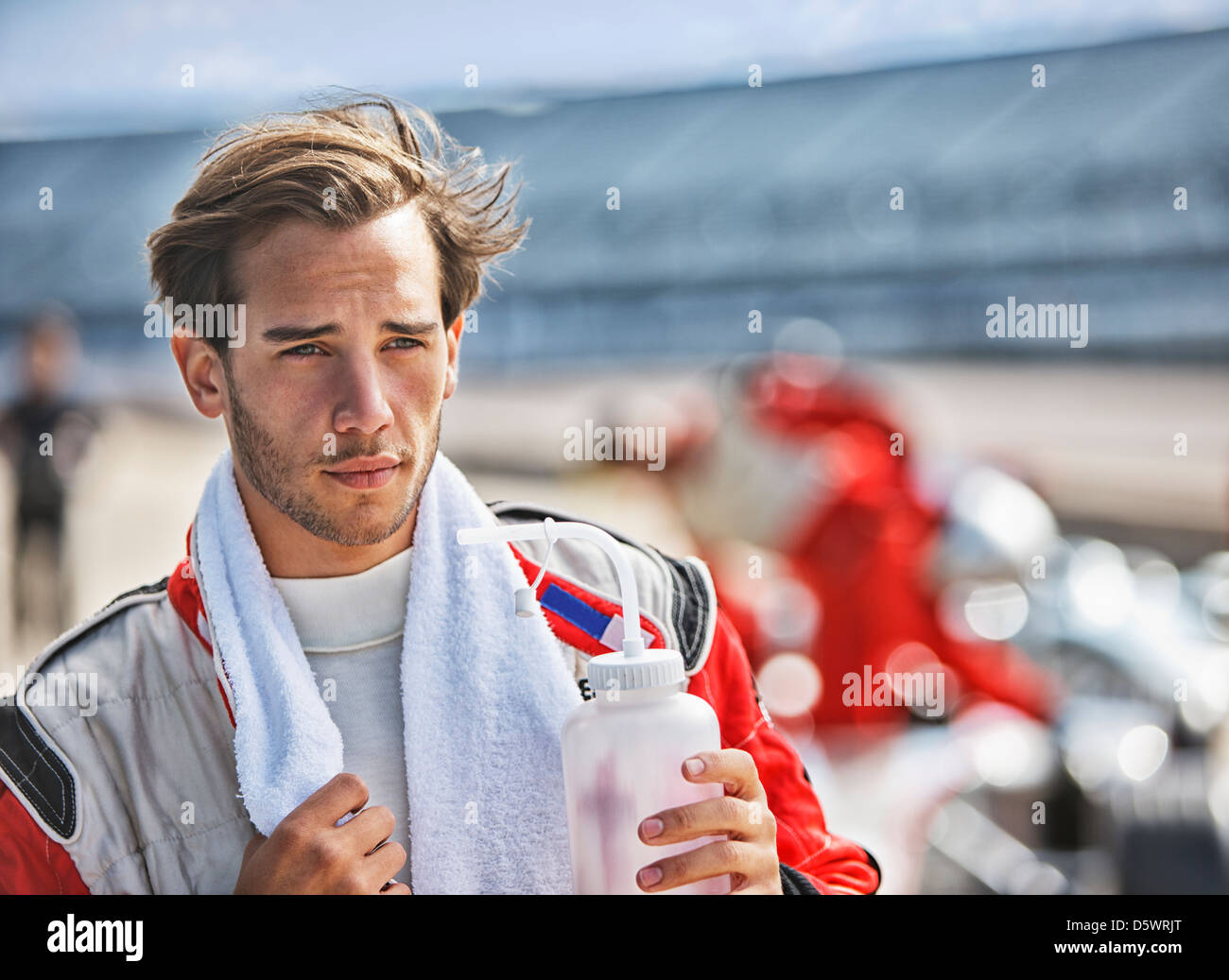 Racer with towel on track - Stock Image