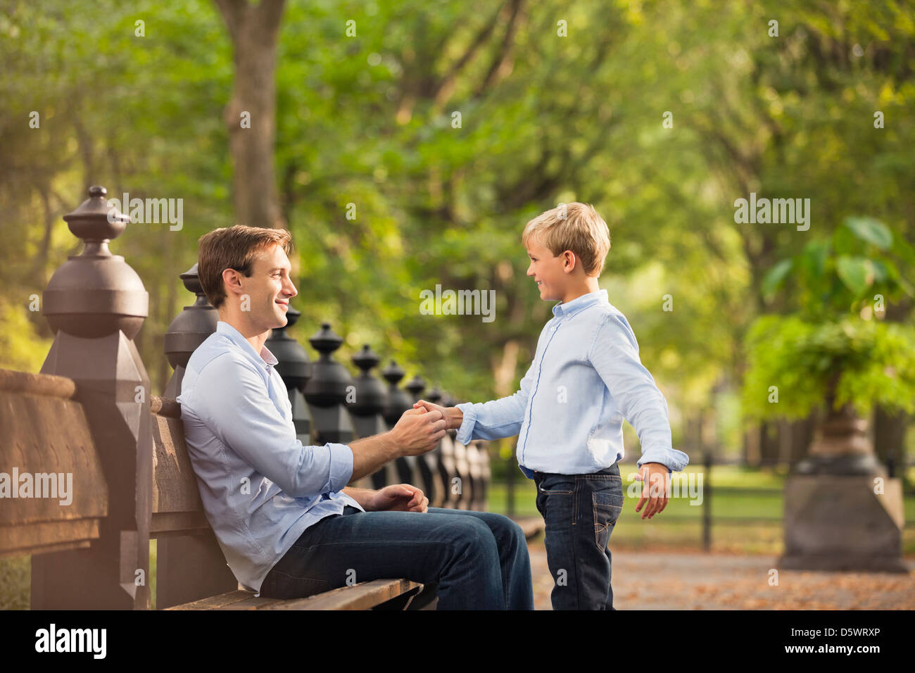 Father and son in urban park - Stock Image