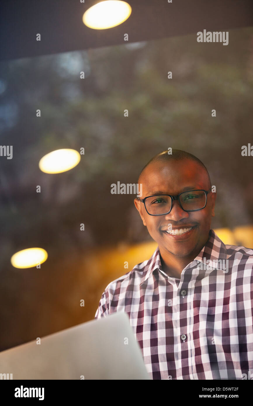 Man carrying papers indoors - Stock Image