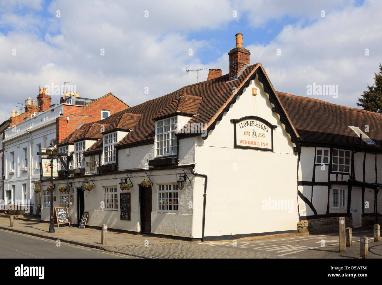 The Windmill Inn is a traditional 16th century black and white timbered building in Stratford-upon-Avon Warwickshire - Stock Image