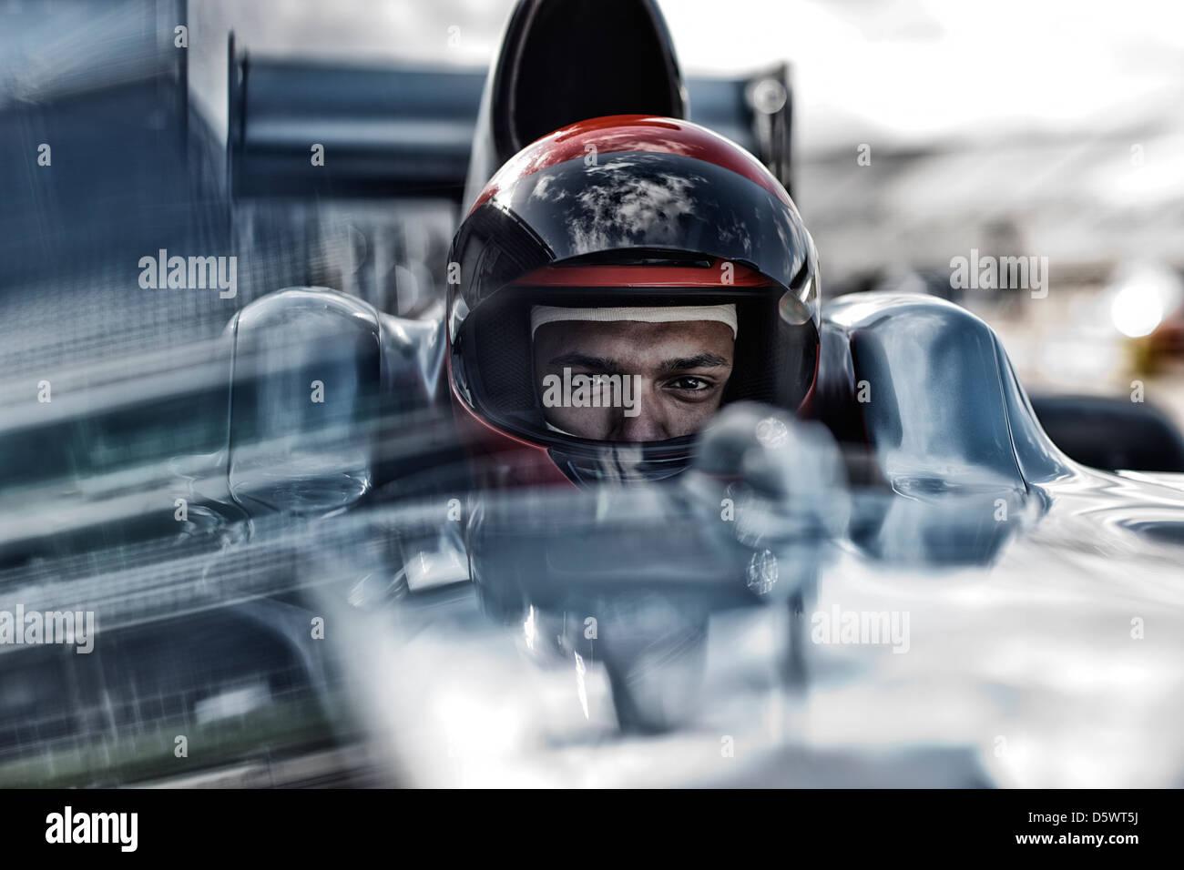 Racer sitting in car - Stock Image