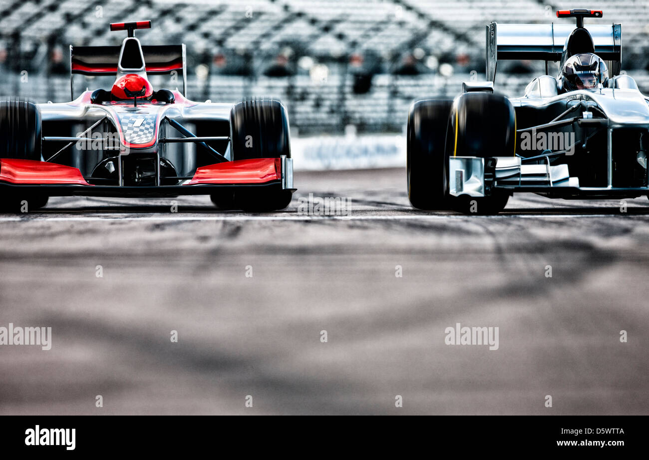 Race cars driving on track - Stock Image
