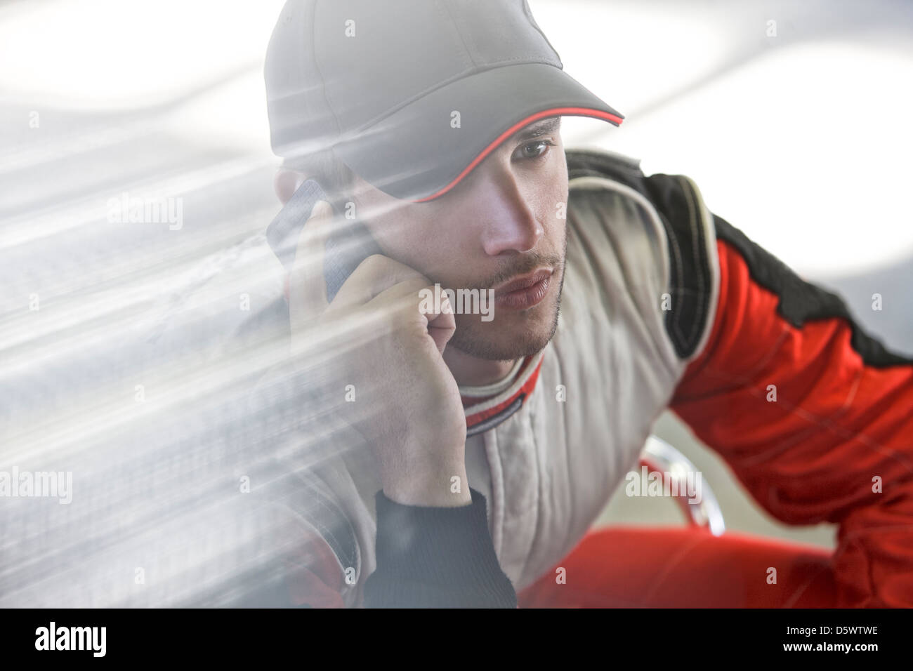 Racer talking on cell phone - Stock Image