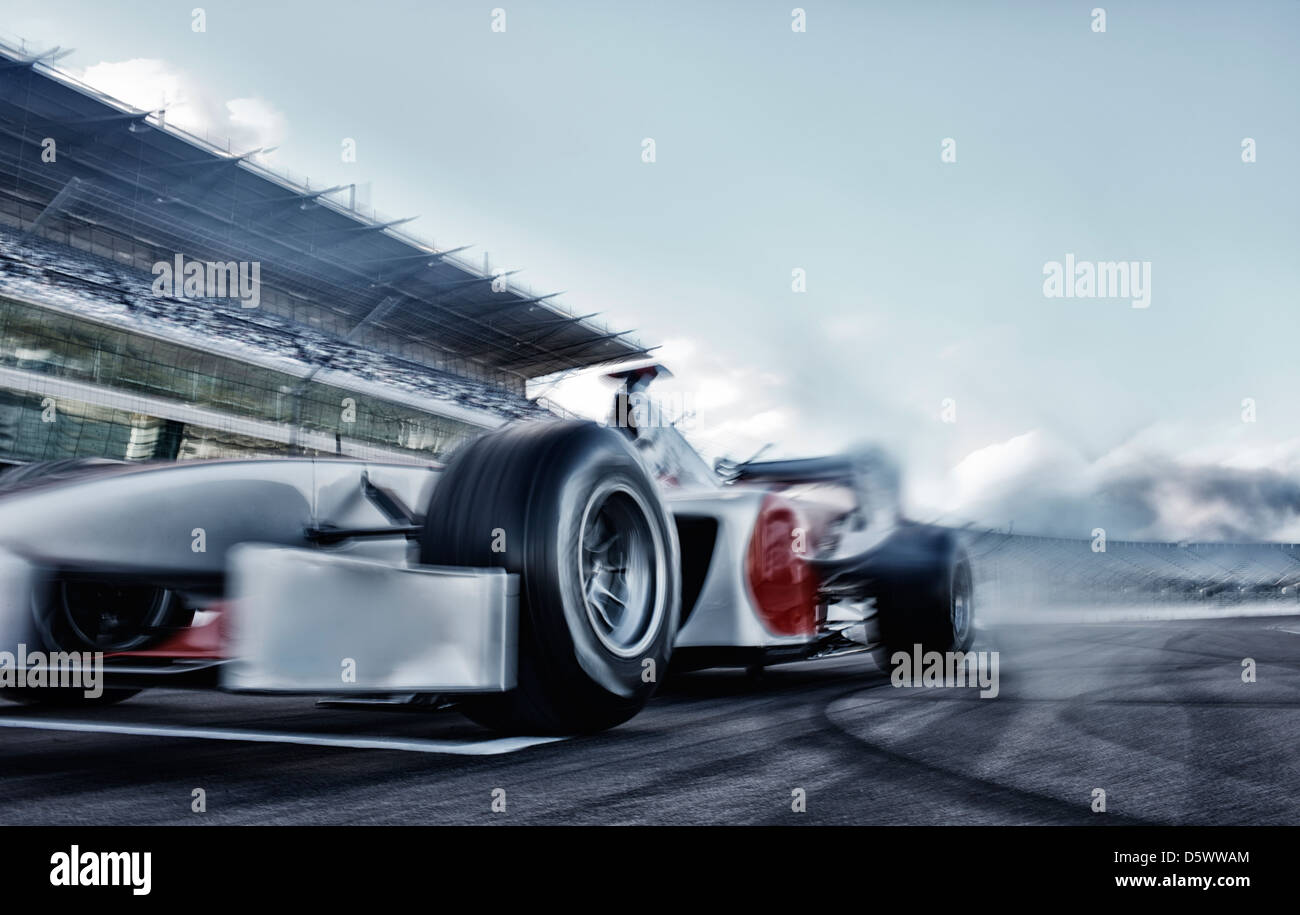 Race car driving on track - Stock Image