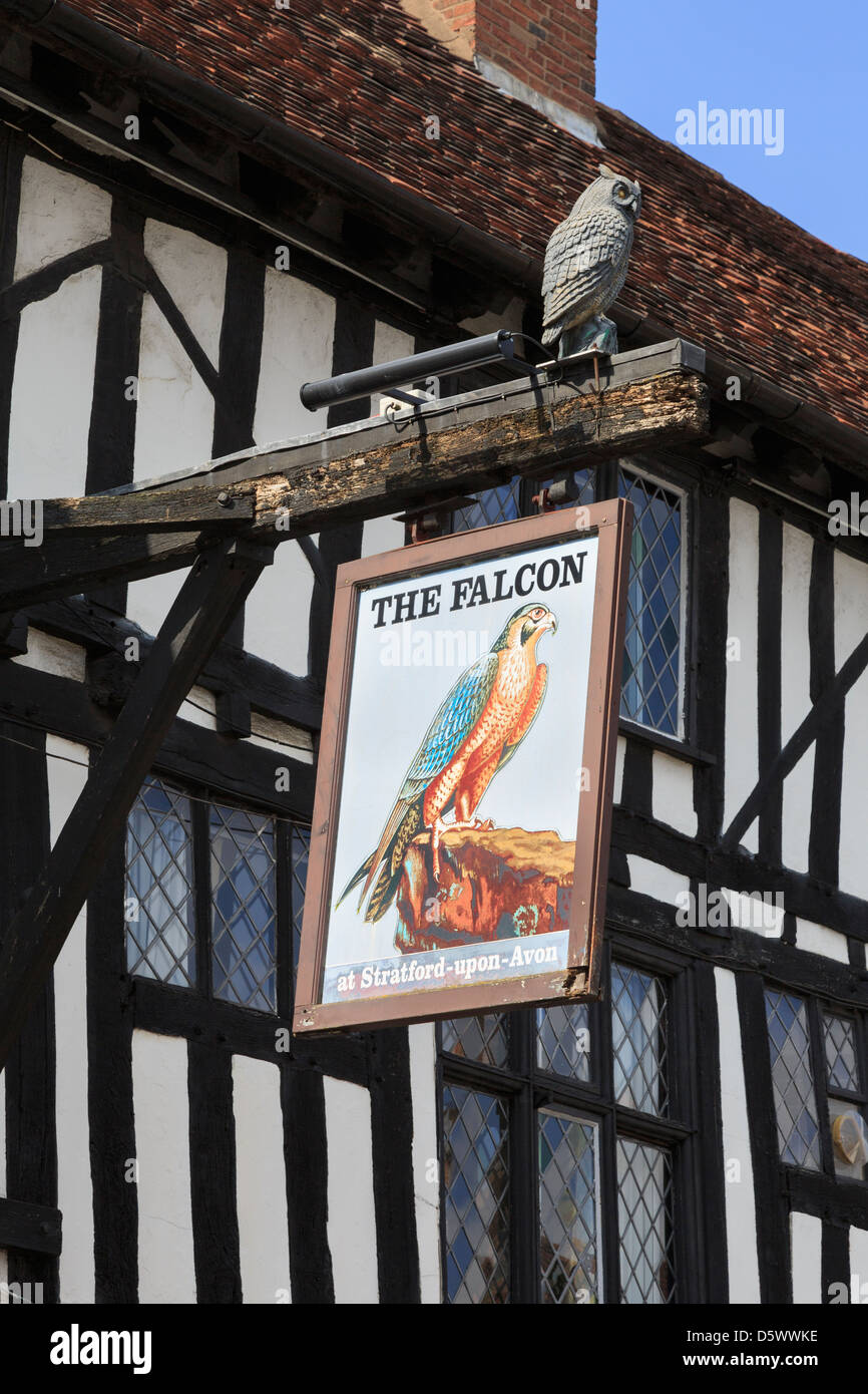 Pub sign for the Legacy Falcon Hotel 16th century black and white timbered building in Stratford-upon-Avon Warwickshire - Stock Image