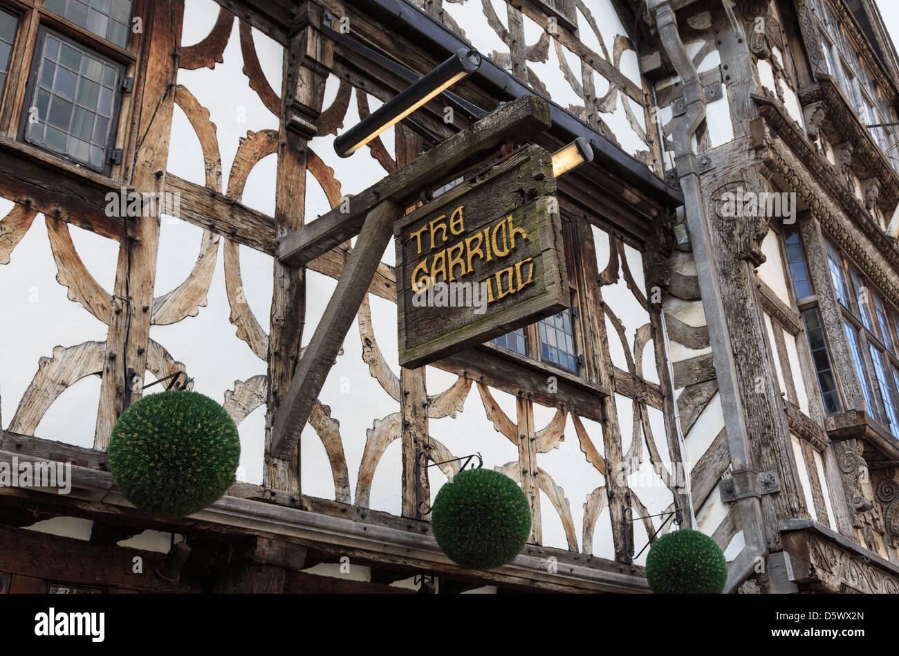Pub sign for traditional 14th century Garrick Inn black and white timbered building. Stratford-upon-Avon Warwickshire - Stock Image