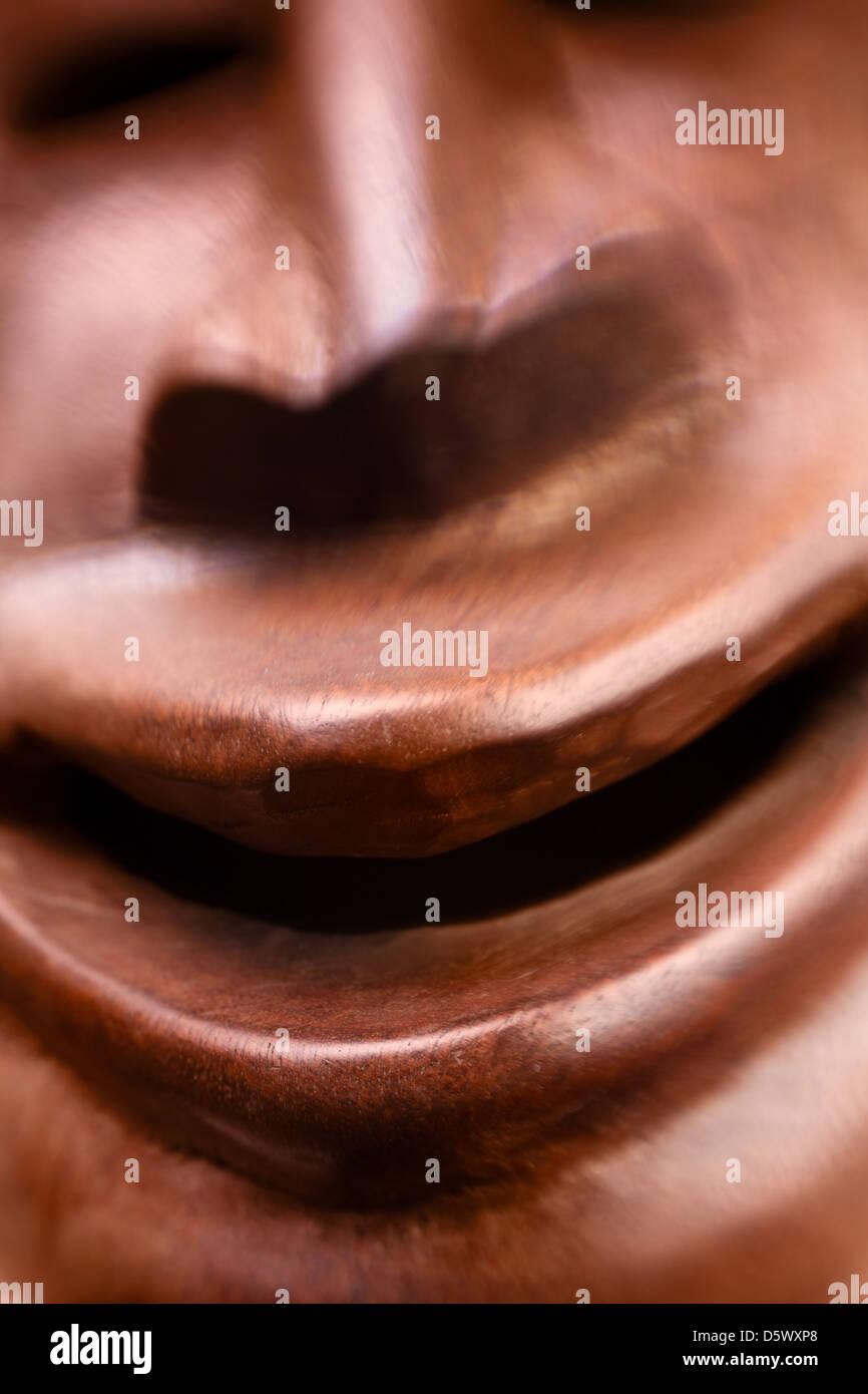 creepy smile african mask closeup - Stock Image