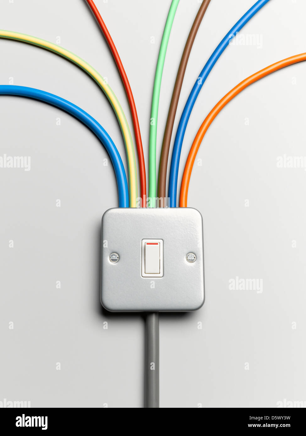 Colorful cords from light switch - Stock Image