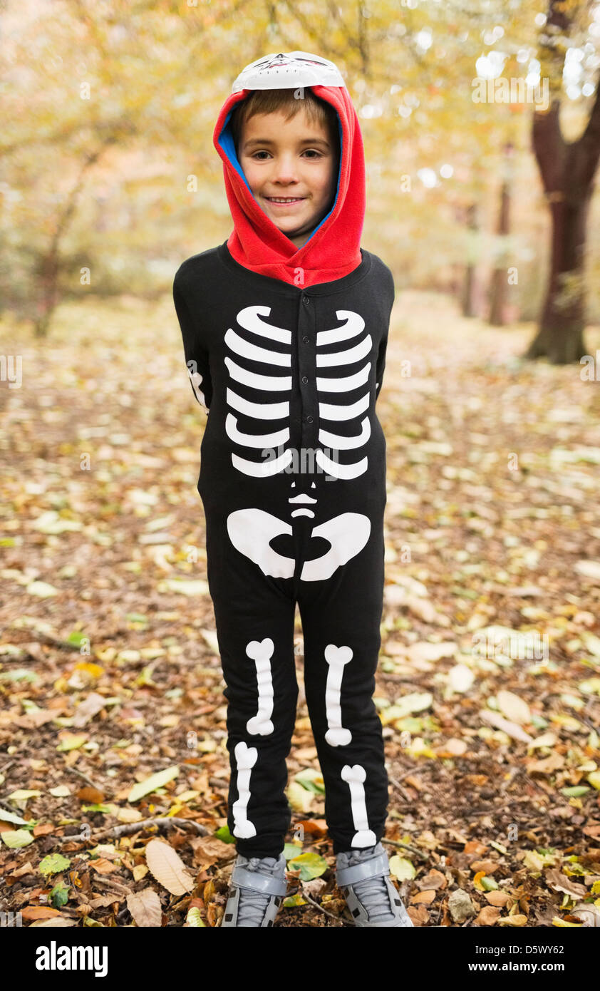 Boy wearing skeleton costume in park - Stock Image