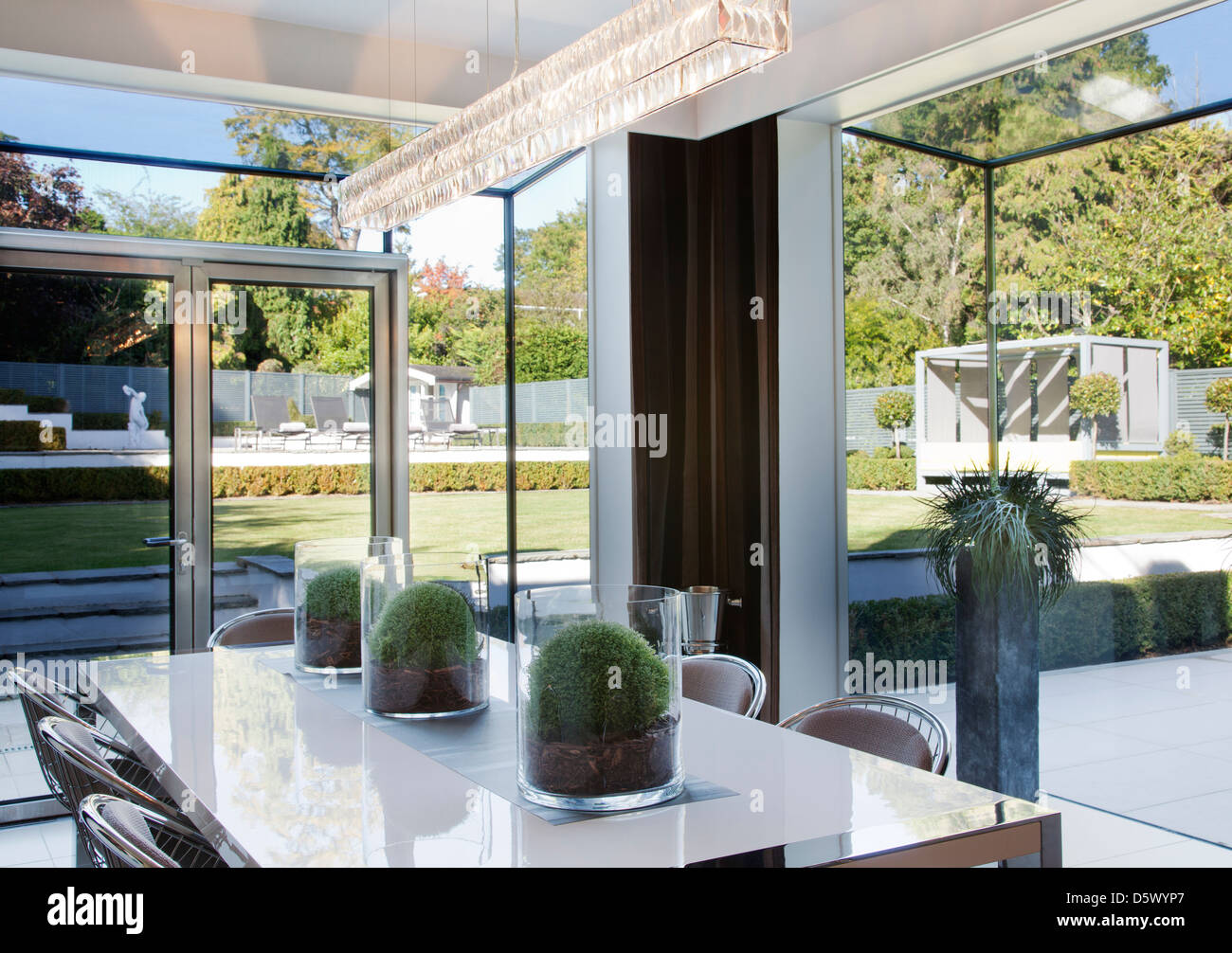 Centerpieces On Table In Modern Dining Room Stock Photo Alamy