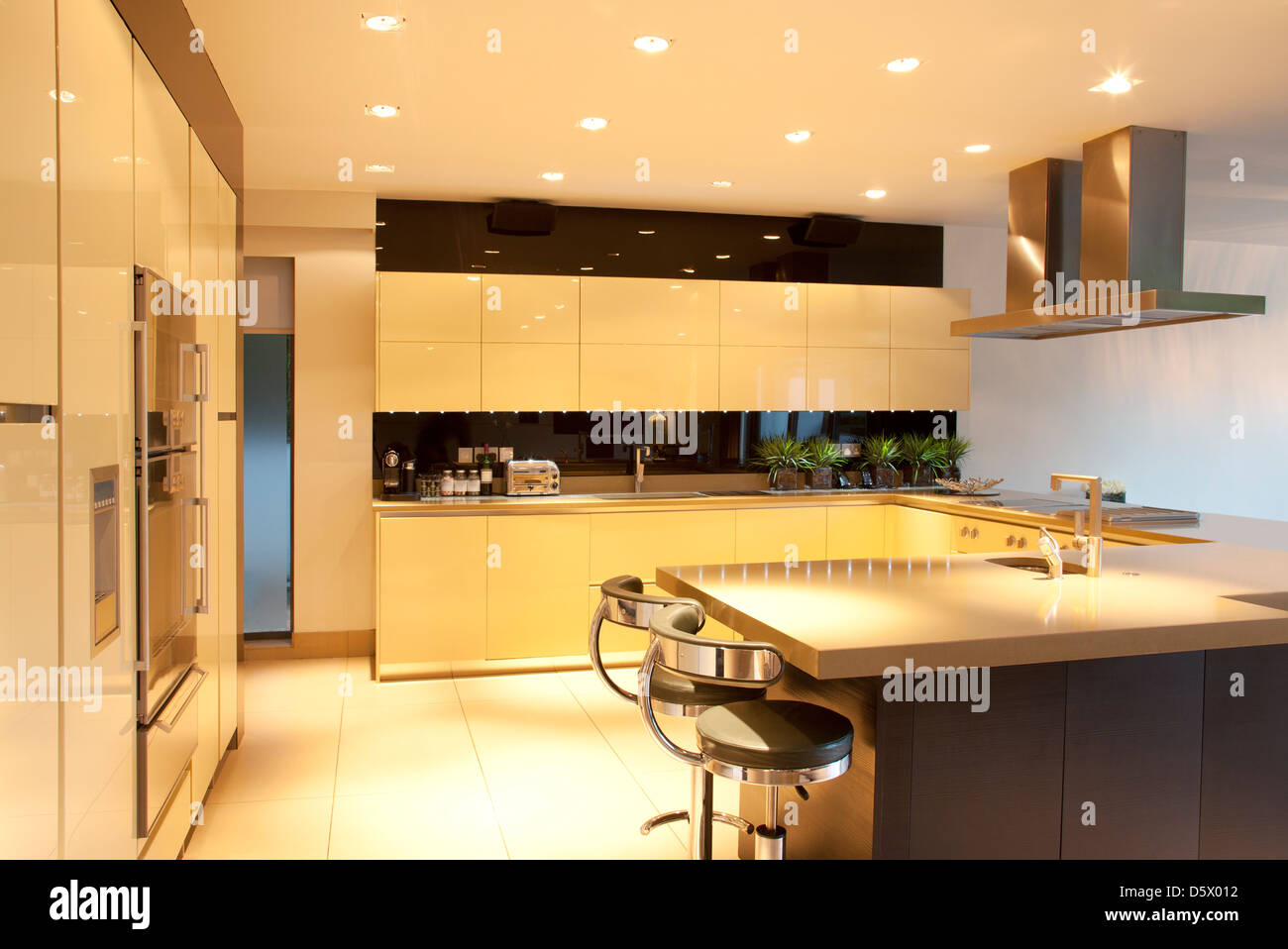Counters and lighting in modern kitchen - Stock Image