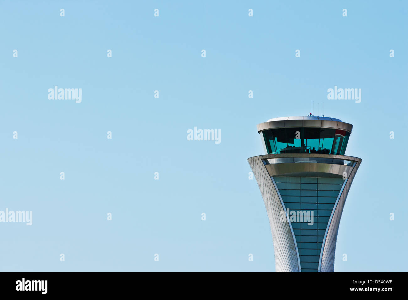 Air traffic control tower and blue sky - Stock Image