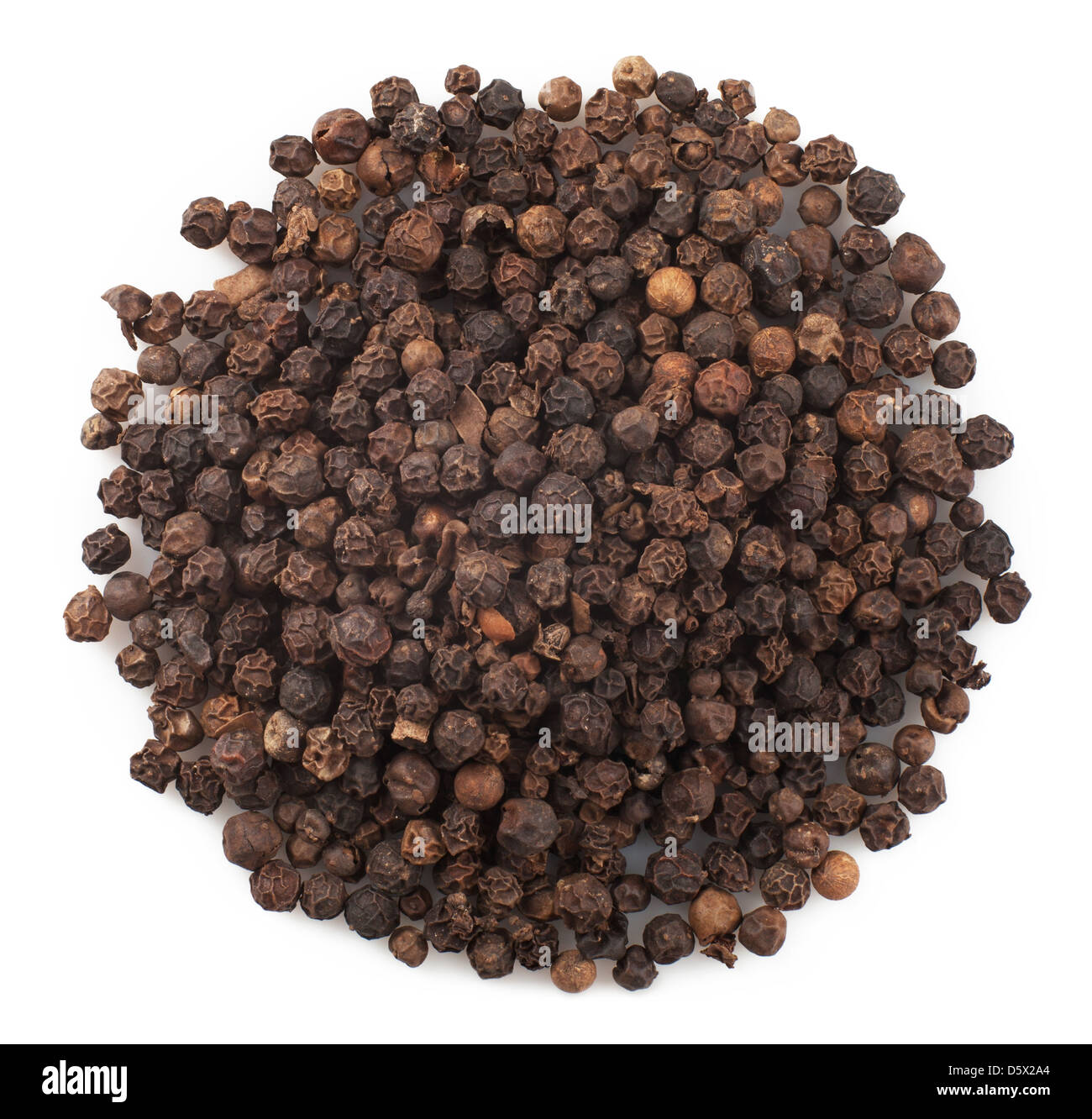 Close up of black peppercorns in isolated white background - Stock Image