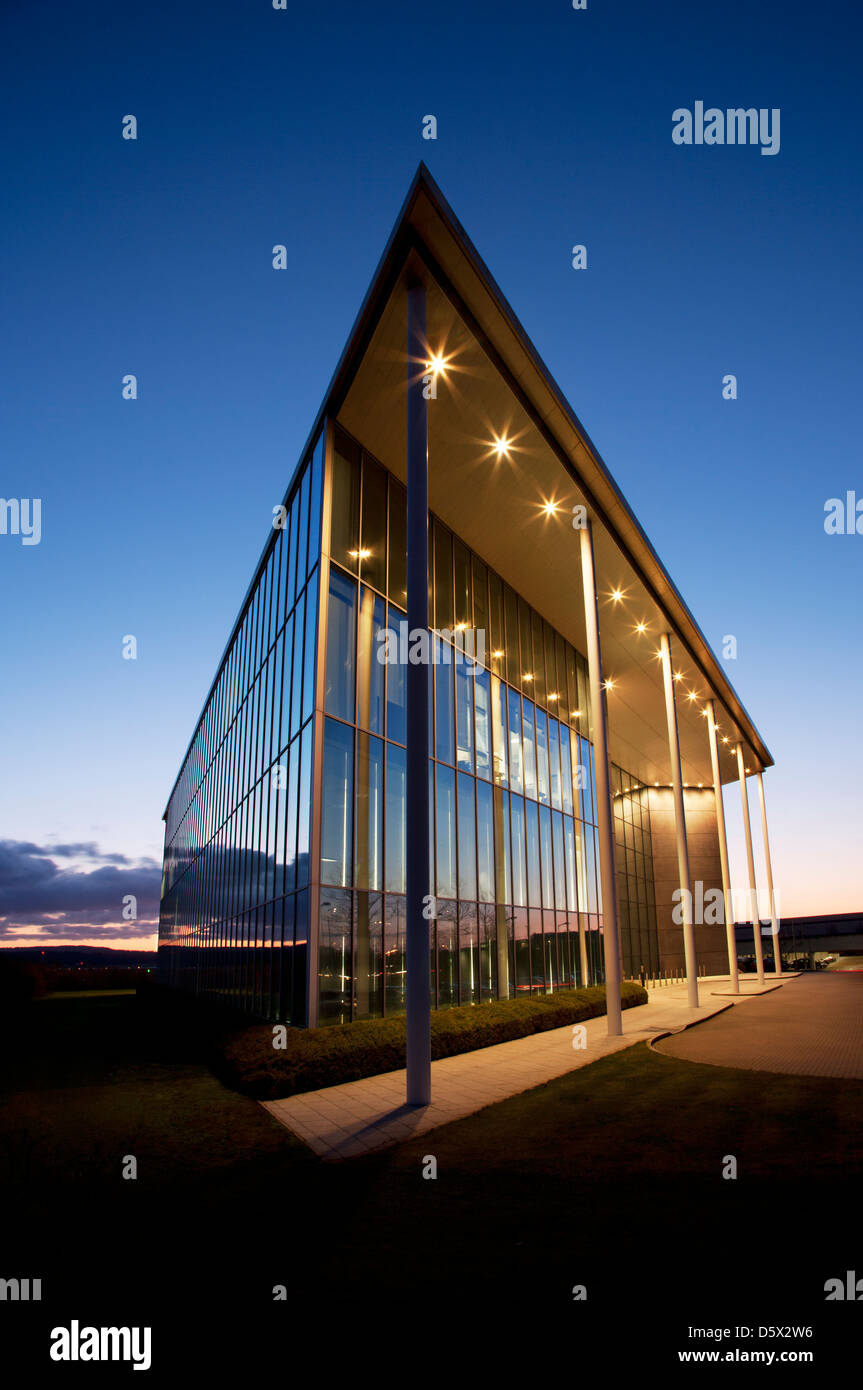 Modern building and sunset sky - Stock Image