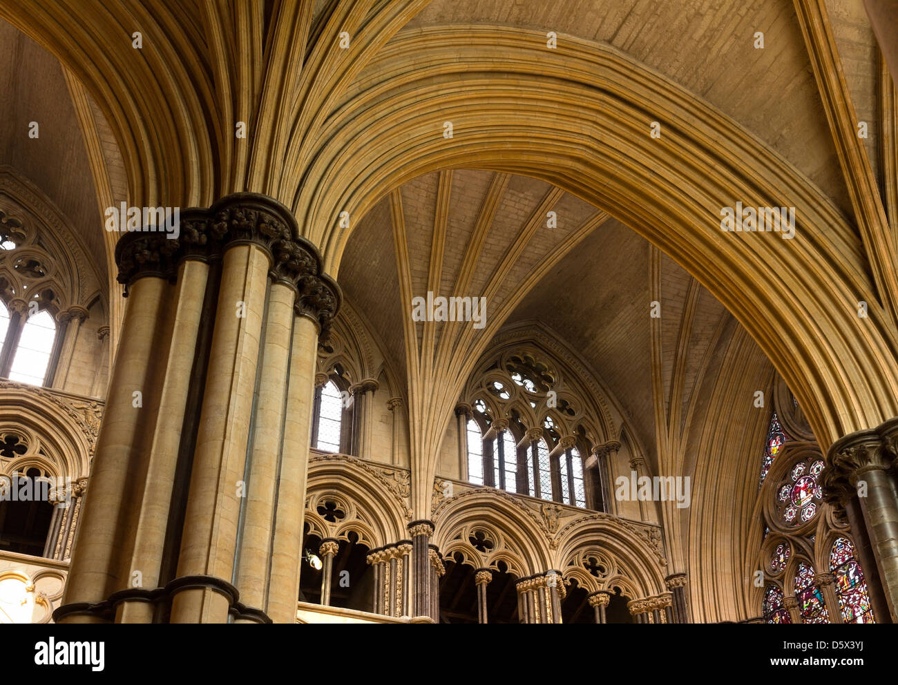 Pointed Gothic masonry arches, stone pillars and vaulted ceilings, Lincoln Cathedral, Lincolnshire, England, UK Stock Photo
