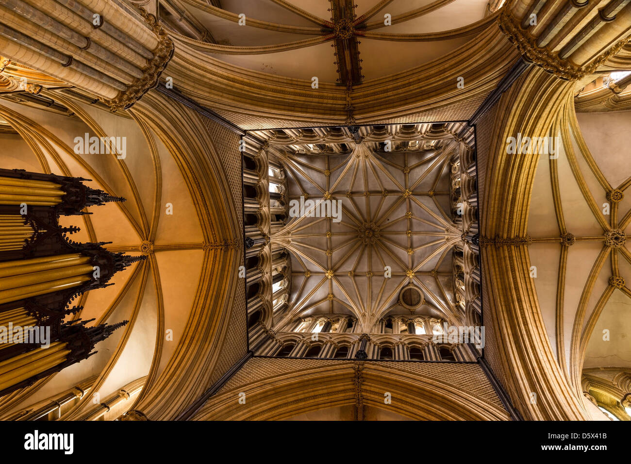 Pointed Gothic masonry arches, stone pillars and vaulted ceilings under the central tower of Lincoln Cathedral, Stock Photo