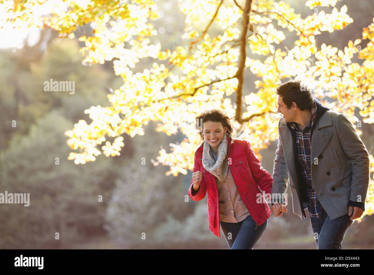Couple walking together in park - Stock Image