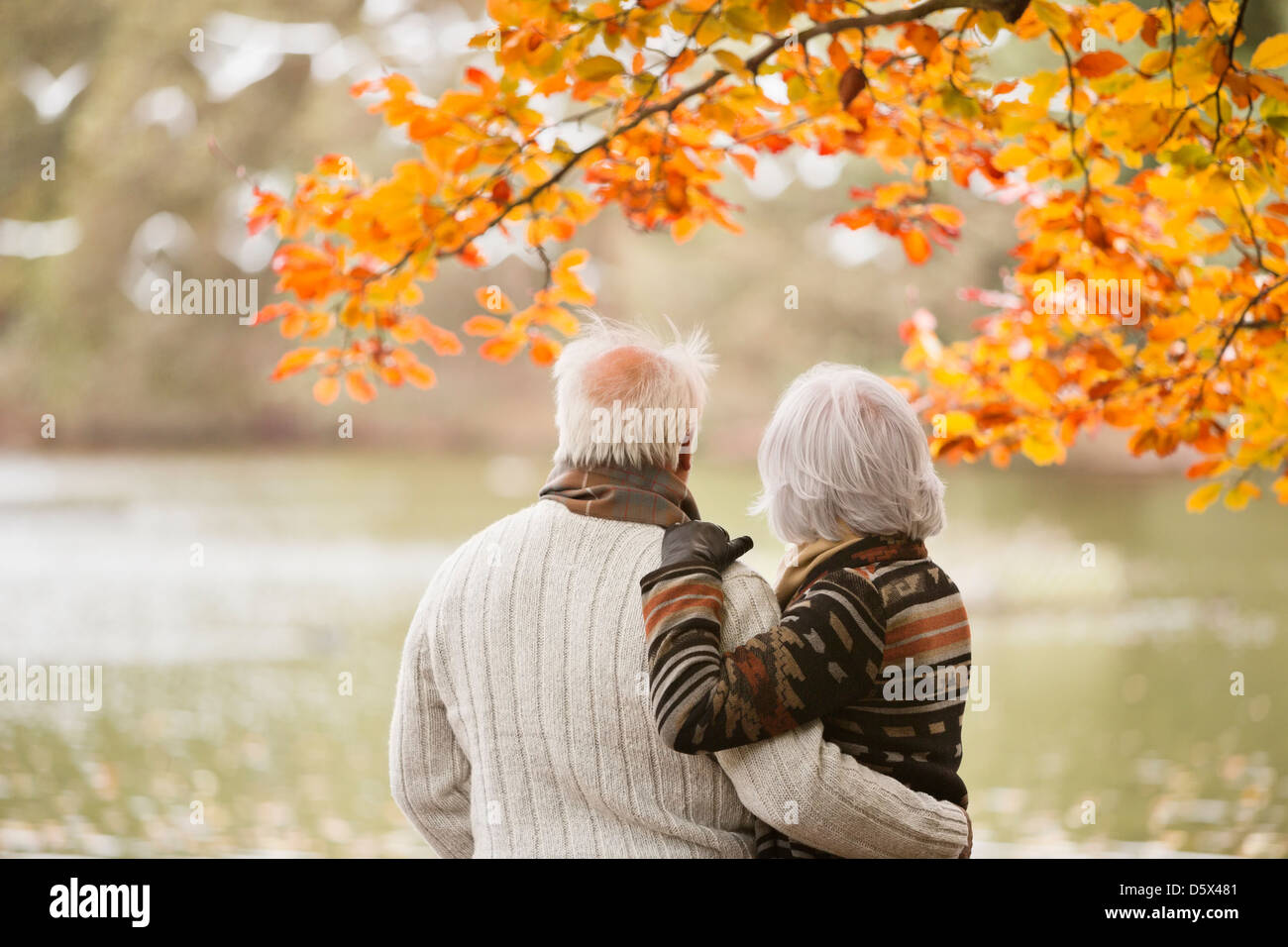 Older couple standing in park Stock Photo